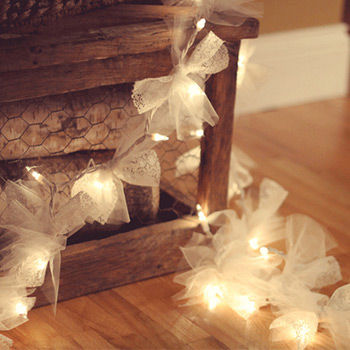 squares of tulle fabric tied onto string lights